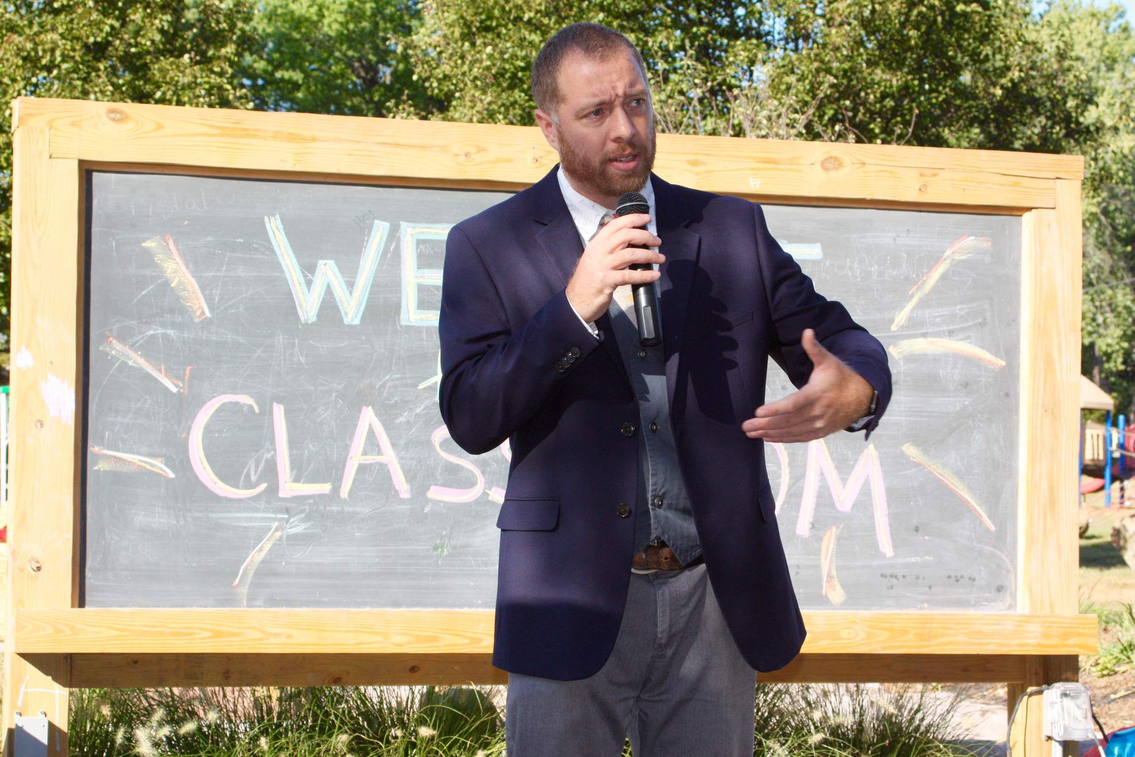 olc-grand-opening-frye-speaking-auth-photo